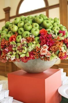 Fit for a wedding, but could also be used for Rosh Hashana. Combine fruit and flowers to create a beautiful piece with many textures and color.
