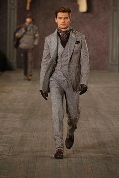Elegantes Herbstoutfit aus braunmeliertem Tweeddreiteiler und dunkelbraunen Accessoires.   Joseph Abboud
