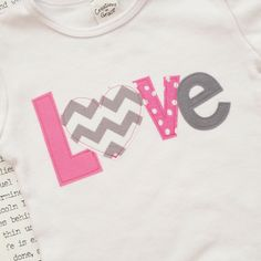 Pink and Gray Girls' Valentine's Day Love Applique Onesie or T-Shirt - Baby Valentine's Day Outfit - Chevron. $17.99, via Etsy.