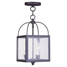 Cast a warm glow in your dining room or master suite with this box-shaped pendant, showcasing seeded glass panels and a bronze finish. Converts into a semi-f...