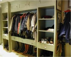 mudroom with sage green open closet/shelves/boot storage - Francie Readman Interiors
