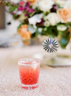 When it comes to timeless tableware, nothing beats the little tumbler that could. It's informal enough to use at home for weeknight dinners but formal enough to use to serve Champagne or cocktails at weddings. Hurrah!  Photo by  Hunter Photographic via 100 Layer Cake