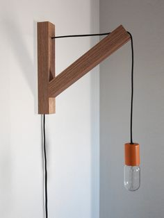 There's no hiding the cord on this wall lamp by Dino Sanchez. Indeed, it's the cord that is the lamp, along with a solid oak bracket. I love the blackened oak version, shown below, but … Deco Luminaire, Decoration Originale, Wood Lamps, Wooden Walls, Cool Lighting, Wooden Diy, Lamp Light, Light Fixtures, Wall Lights