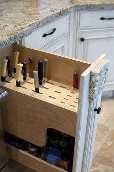 knife drawer.  the only knife organizer I have ever wanted stores UNDER the kitchen cabinets, hiding them there.  if anyone knows where I can find one, please comment!