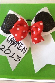 Minnie Cheer Bow on Etsy, $14.00.  Ordering these for all my little cheerleaders for Disney!