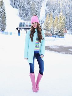 This outfit, only reversed: jeans with mint Hunter boots, a mint beanie, and a pink pea coat over a printed sweater.