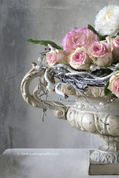 We have a few of these antique french cast iron planters, they look amazing with gorgeous flowers in and would make a statement in your dining room.