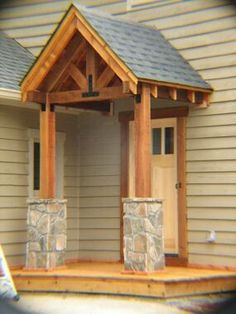 **Incorporate cedar and/or shakes in porch to tie into barn? Cedar P/B Portico, stone recycled from demoed landing, cedar deck, R/S cedar trim around door, Simpson Strong-Tie Architectural series metal connectors. Porch Columns, Porch Roof, Front Porch Pergola, Front Porch Remodel, Front Door Porch, Pergola Roof, Pergola Kits, House With Porch, House Front