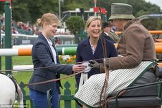 Sophie Wessex looked to be in very high spirits as she and daughter Lady Louise (left) handed out rosettes at theBurghley Horse Trials today