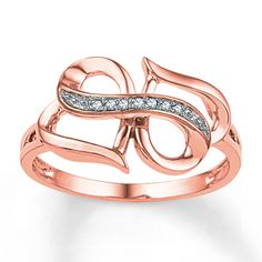 This unique ring for her combines hearts and the infinity symbol - two powerful ways to express your love. Accented with a line of sparkling round diamonds, the ring is fashioned in 10K rose gold.
