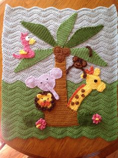 Adorable and cheerful crochet jungle theme baby blanket! This blanket is made just for you and can include your favorite animal and colors. Basic blanket includes lion, giraffe, elephant and a monkey in a palm tree. Super soft, 100% acrylic yarns are used. Perfect for a baby shower gift! Approximate size: 27 x 33 This blanket is custom made... please allow 2-weeks to complete. Email with any questions. :-)