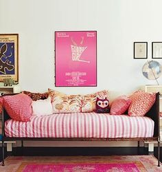Amanda Peets day bed with pink pillows and striped coverlet and pink wall art from Domino Magazine