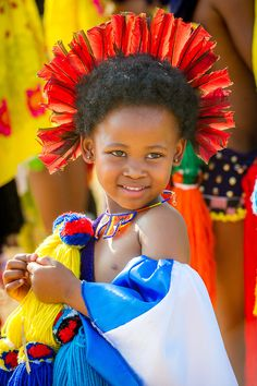 Ludzidzini, Swaziland, Africa - Annual Umhlanga, or reed dance ceremony, in which up to 100,000 young Swazi women gather to celebrate their virginity and honor the queen mother during the 8 day long event.<br /> Maidens present cut reeds to the queen mother of Swaziland for her Kraal