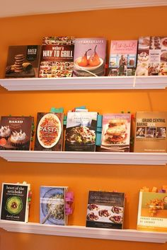 Great way to display cookbooks and keep the currently used ones both out and out of the way!   10 Beautifully Organized Cookbook Collections