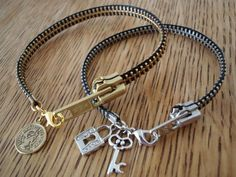 Zipper Bracelet:  After cutting the cloth away use a lighter to trim up the edges close to the zippers and  use a tiny drill bit to put the rings through to hold the lobster clasp. I added charms and Presto... a couple real cool bracelets that people seem to really like.