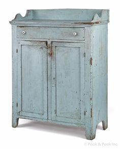 "Pennsylvania painted pine jelly cupboard, 19th c., retaining a robin's egg blue surface.  52-1/2"" H. x 38"" W."