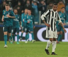 Douglas Costa of Juventus FC shows his dejection during the UEFA Champions League Quarter Final Leg One match between Juventus and Real Madrid at Allianz Stadium on April 3, 2018 in Turin, Italy.