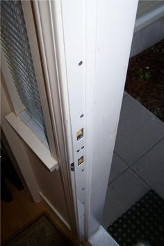 """Reinforced door frame with steel (product seen here is called """"rebar door security device""""). Good for preventing intruders and fixing cracked door jams. (If you have a crack, repair and sand it with wood putty first)."""
