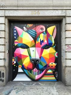 "Walking along Lafayette Street in NYC's Nolita neighborhood the other day I came across this incredible geometric painting ""Soho Dog"" by Spanish artist Okuda San Miguel."