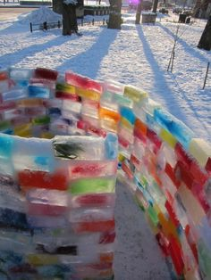 A spiral Rainbow Castle in Liisanpuisto, Helsinki, Finland, made in January 2013 by a group of families, inspired by the family in Edmonton - http://www.thisiscolossal.com/2013/01/how-to-build-a-rainbow-igloo/