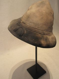 ITALIAN, Venice. Circa 1920. [PEASANT] Great charm and light humor comes from hand-made terracotta hat molds. Originally employed to fashion thin costume hats for the infamous carnivals threading throughout Venice, these molds are now museum-stand mounted for use as object-cum-sculpture.Which is your favouriteSizes vary per piece.