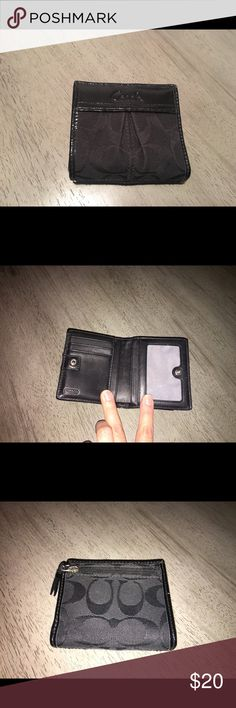 Coach wallet Old school wallet. Black, good shape, used maybe for a month back in the day and has since been sitting in my closet. Clear plastic slot has some scratches. If you have any questions feel free to ask. Coach Bags Wallets