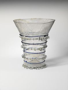 Beaker with Cobalt TrailingDate:     1275–1325 Culture:     Central European Medium:     Clear glass, cobalt trails Dimensions:     Overall: 5 1/4 x 4 1/2 in. (13.3 x 11.5 cm) at foot: 2 3/4 in. (7 cm)