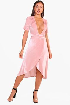 1ff7421e0d Click here to find out about the Tara Angel Sleeve Velvet Midi Skater Dress  from Boohoo