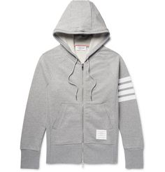 Keep your casual roster on-point with Thom Browne's hoodie. Crafted in Japan from soft loopback cotton-jersey, this light-grey piece is cut to be fitted and detailed with the label's signature stripes on one sleeve. Wear it with the matching sweatpants at the weekend.