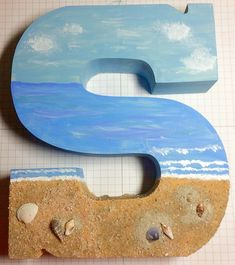 Craft Letter Beach Painting Art with Sand & Shells - Lovely craft letter S painting with a beachy scene, added sand and shells inspired by this post (cl - Sea Crafts, Seashell Crafts, Rock Crafts, Diy Arts And Crafts, Cute Crafts, Crafts To Sell, Baby Crafts, Paper Crafts, Sharpie Crafts
