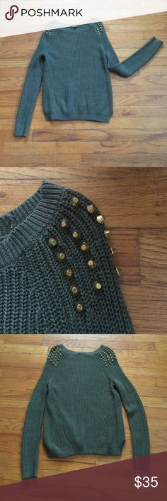 Olive green Express sweater A must have color for fall - olive green. This sweater is super cute with gold stud accents on the shoulders. Two cute side slits. Very soft cotton/acrylic blend. Very good used condition.  Size small. Express Sweaters Crew & Scoop Necks