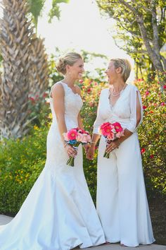 Gorgeous couple!  Love how her pantsuit compliments her dress!