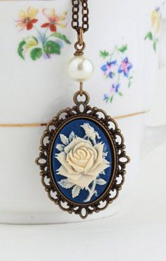 Necklace Purple and Ivory Flower Cameo -- I love cameos and I particularly love the blue background color on this one -Ann