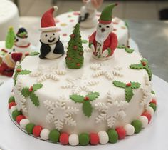 Christmas Cake with icing tree, santa, snowman, snowflakes and holly.  Can you fit more Christmas Cheer onto one cake?