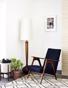 Living Room - A vintage armchair grouped with a wood floor lamp, potted plants and a Beni Ourain style rug