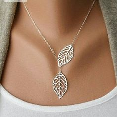 NECKLACE There is no clasp for this necklace as the leaf goes through to make a necklace this is silver but not sterling silver very pretty and cute necklace  ?NEW LISTING ? Jewelry Necklaces