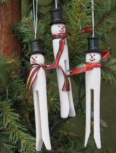 "Snowmen Clothespin Ornaments~ Turn an old-fashioned wooden clothespin into an ornament. Use paint pens to make face, orange toothpick for  ""carrot"" nose and a black top-hat or piece of old sock or piece of an old sweater for a sock cap and scarf.  The scarf can also be sprinkled with glittering ""snow"". (Note: these snowmen are for sale but it's also great inspiration to make some of your own.)"