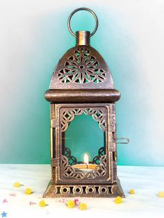 Unique Vintage Scheherazade Exotic Lantern/ Morrocan Decor/ Filigree Metal Candle Holder. $12.00, via Etsy.