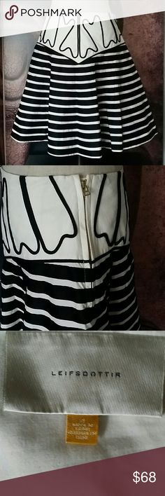 Anthropologie ❤ Leifsdottir Striped Flare Skirt Such a classic look. Black tiered stripes with a wide waistband. Side zip and button. Knee length. Size 4. 100% cotton with a pink polka dot lining. EUC may have been worn once, in gorgeous condition. Anthropologie Skirts Midi