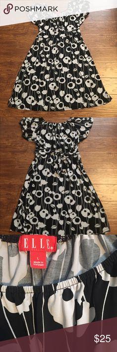 Black & white floral peasant style dress Pretty black and white floral dress by Elle. Tie belt around waist. Pretty print. Stretchy. Elasticized neckline and cap sleeves. elle  Dresses