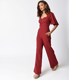 Stay classy and sassy in this Voodoo Vixen frock! The Zoey is a ravishing burgundy red jumpsuit, boasting a stylish sweetheart neckline with wide seamed waist, darting, and dainty underbust gathers for a flattering fit. Topped with fluttery cape sleeves t