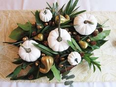 When it comes to seasonal decorating, for the most part I like to keep things simple and neutral.  I wanted to create a centerpiece that reflected that for the�