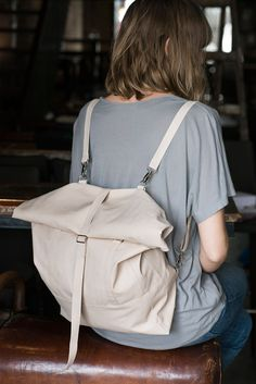 A sleek, versatile, city & vacation backpack that can convert into a tote bag, designed by Lee Coren.  in Nude vegan leather, this rolltop is ready for an adventure!  + The Wanderlust rolltop was designed with thought to our modern traveling habits, and risks - the open, yet deep, cell phone pocket is located at the back to ensure it's safety, and the top zip closure of the bag + roll makes it extra anti-theft.