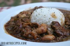 Cajun smothered okra with falling of the bone tender chicken, and smoked sausage. Serve it with hot rice & crusty french bread, and you have an amazing meal! I LOVE cajun smothered okra with ch…
