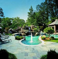 Heated pool with Lazy rizer that wraps around the house, gooood lord Outdoor Spaces, Outdoor Living, Outdoor Decor, Outdoor Stuff, Outdoor Ideas, Swim Up Bar, Luxury Pools, Side Yards, Dream Pools