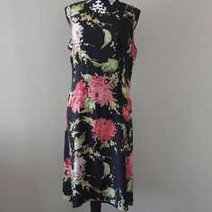 "Talbots Floral Dress Women's Talbots Sleeveless Dress? Knee length? Back zipper with open keyhole tie? Black with multi color floral print? Pure Silk (care tag was removed but should be dry cleaned)? Lined? Size 16? Worn once or twice EUC? Measurements laying flat:? Underarm to Underarm: 19.5""? Waist: 17.5""? Length: 43"" Talbots Dresses"