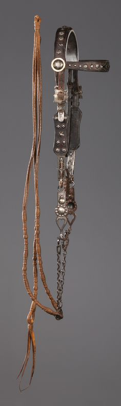 Exemplary early California Bridle & Bit with Maria Leyva Santa Ynez Reins. Hard-to-find, early 1900s Southern California headstall with coin silver ornamental mountings that feature stars, diamonds and poppies on the headband, noseband and cheeks, 3-piece coin silver buckle attachment, engraved swivel bracket supporting high spade, silver inlaid heart pattern bit with copper ferrules on the braces and featuring impressive overall file work. Attached to the headstall is an extremely scarce…