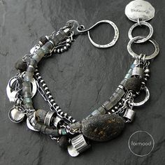 Bracelet is made of oxydized and rubbed silver 925, raw baltic amber, labradorite.  Dimensions: Stones: 3-22 mm (0,20-0,87 inches) silver elements