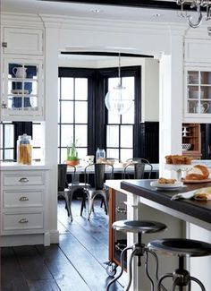 cabinets see thru to dining room, built ins around room, room divider, dark dining room, kitchen dining