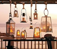 Several lanterns hung at varying heights from a wooden ladder (saw this at Pottery Barn). Patio Lanterns, Hanging Lanterns, Candle Lanterns, Hurricane Lamps, Lanterns Decor, Ideas Lanterns, Vintage Lanterns, Hanging Lights, Decorative Lanterns